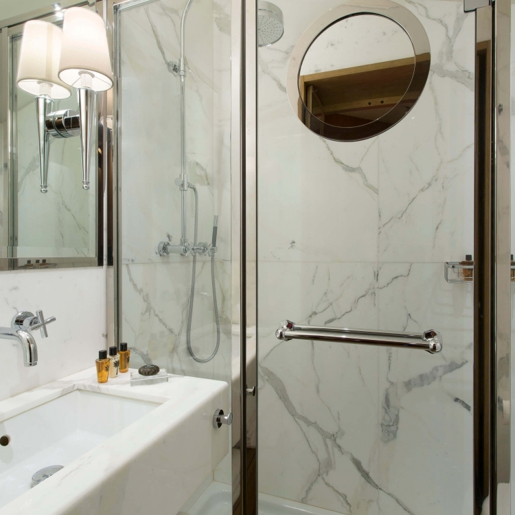 Marble bathroom with luxurious shower. Guest amenities.